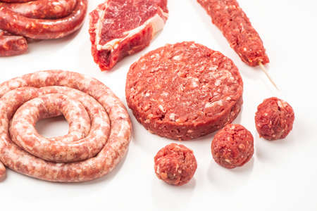 Assortment of semi-finished meat products on white background