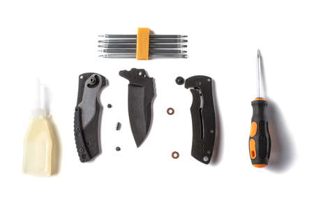Bottle of household oil, parts of a pocket knife and screwdriver tools 免版税图像