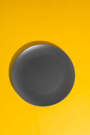Top view on an empty gray plate Stock fotó