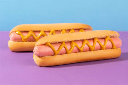 Close-up on fresh hotdogs with mustard zigzags