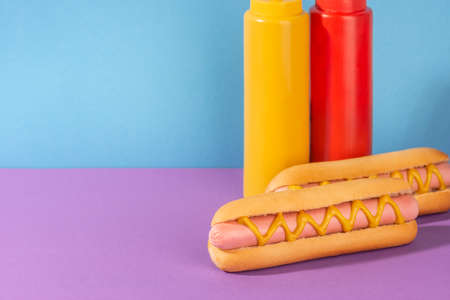 Fresh hotdogs and squeeze bottles of mustard and ketchup