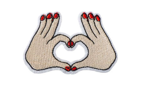 Hands making heart shape, embroidered batch isolated on white background