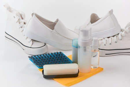 Cleaning kit and white shoes on white background Reklamní fotografie