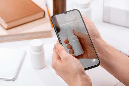 Man using a phone app to identify a spray