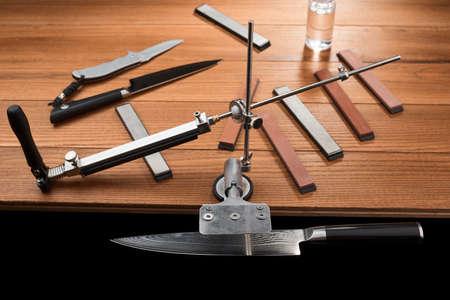 Japanese knife fixed in a manual sharpener machine
