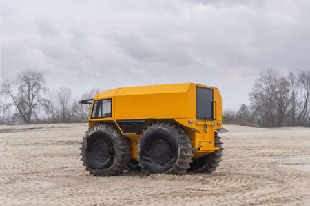 Unique all-terrain vehicle in a sandy area on a cloudy winter day Stock fotó