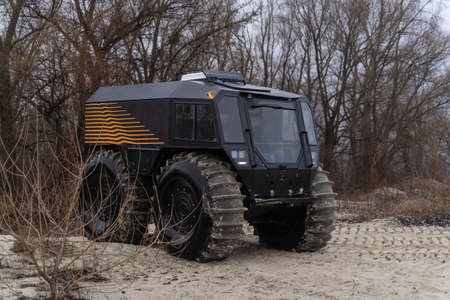Modern all-terrain vehicle driving out of the woods Stock fotó
