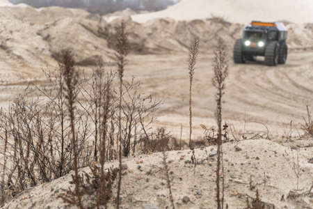 Off-road vehicle driving in the sands