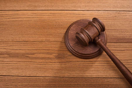 Top view on a judge s gavel and block on wooden background Stock fotó