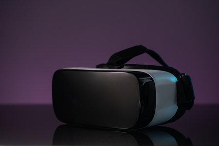 White VR headset on dark violet background