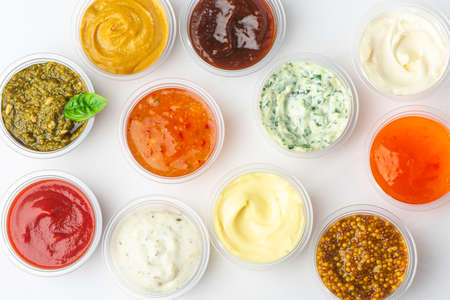 Top view on variety of sauces and condiments on white background Stock fotó