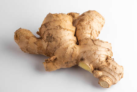 Close-up on a ginger root on white background
