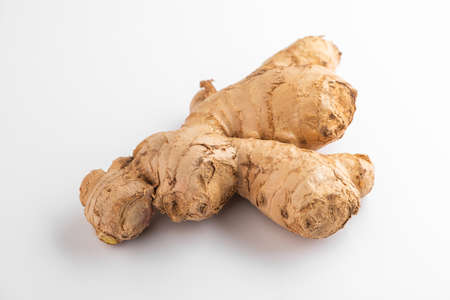 Close view on a ginger root on white background Stock fotó