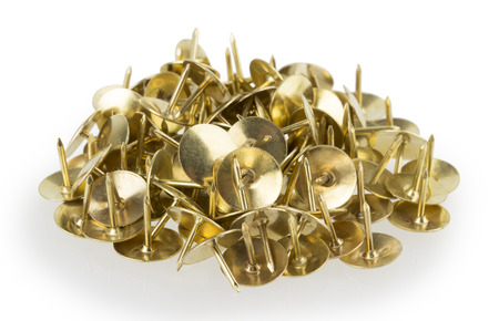 hobnail: Construction nails gold on a white background