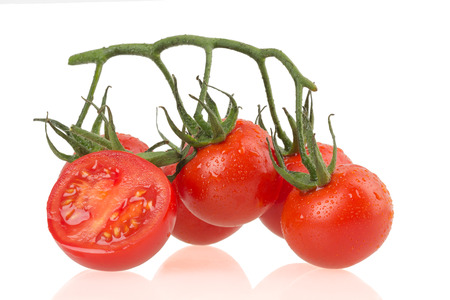 Ripe tomatus on white background. photo