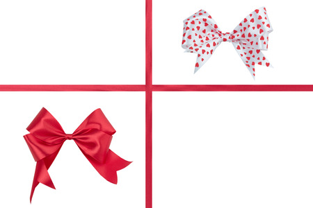Red bow with a ribbon on a white .
