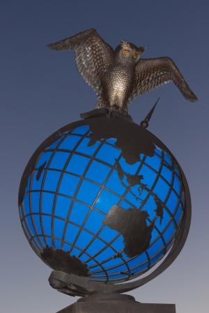statue symbol of knowledge around the world. photo