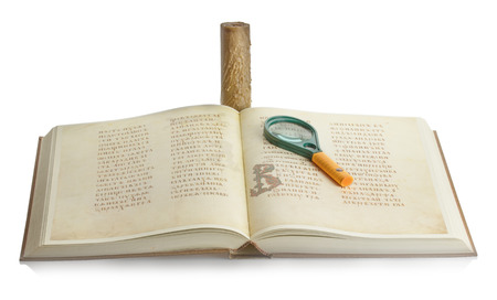 book with a magnifying glass and a candle on a white background. photo