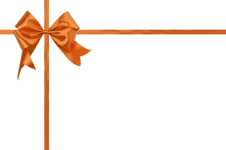 Orange bow with a ribbon on a white .