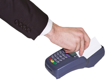 Hand swiping generic credit card on an over counter POS terminal. photo