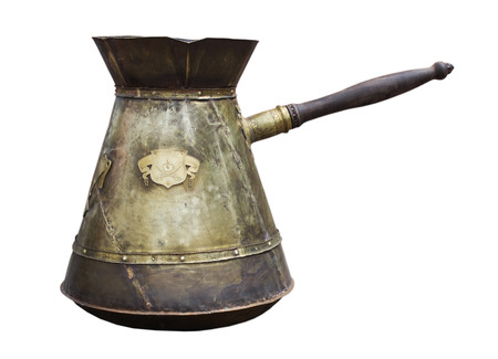 vintage Turkish metal coffee pot on the white background. photo