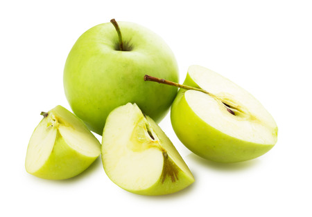 green apples and apple slices on white background.