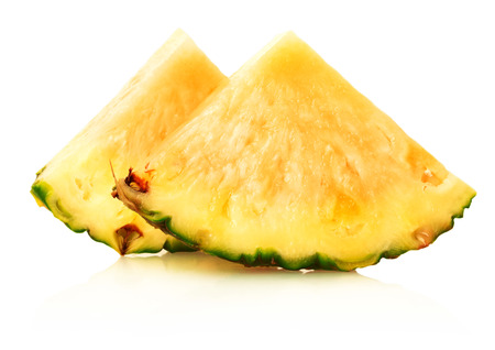 slice of ripe pineapple on a white background. photo