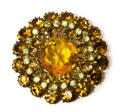 vintage golden brooch with gems in the shape of a flower. photo