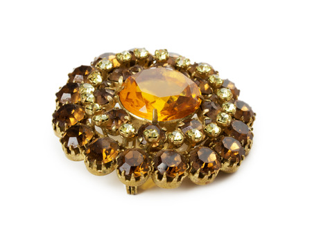 vintage brooch with gemstones on the white background. photo