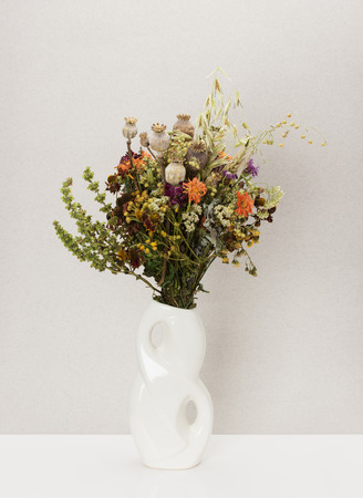Dried flowers in porcelain vase  photo