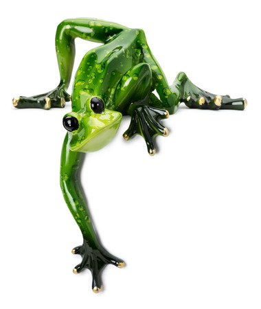 statue of green frog on the white background. photo