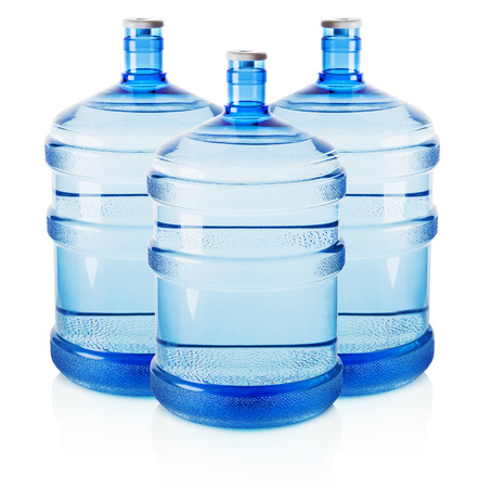 carboy: Three big bottles of water isolated on the white background. Stock Photo