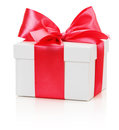 gifting: gifting box with red bow isolated on the white background.