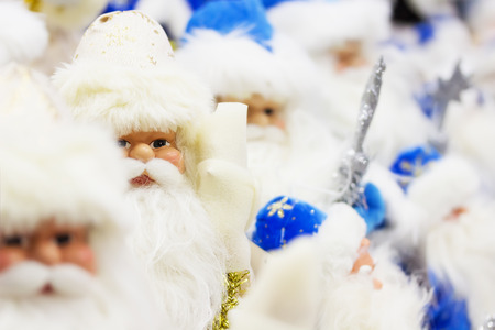 clauses: Santa Clauses in blue clothes. Stock Photo
