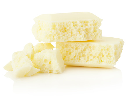 aerated: white aerated chocolate isolated on the white background.