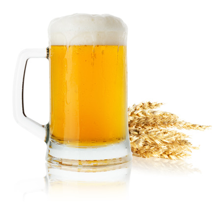 jug of beer with wheat isolated on the white background. photo