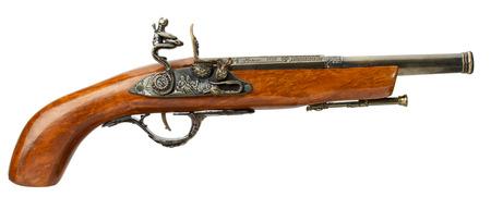 flintlock pistol: retro pistol isolated on white background.