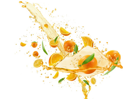 liquid summer: oranges with juice pouring isolated on the white background. Stock Photo