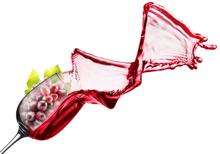 red wine splash with pink grape in glass. Standard-Bild