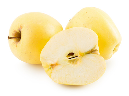 isolated on yellow: yellow apple isolated on the white background.