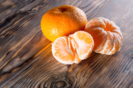 lemon: tangerines on the wooden background.