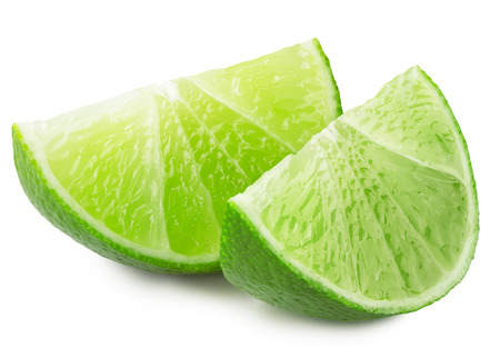lemon: juicy lime slices isolated on the white background. Stock Photo