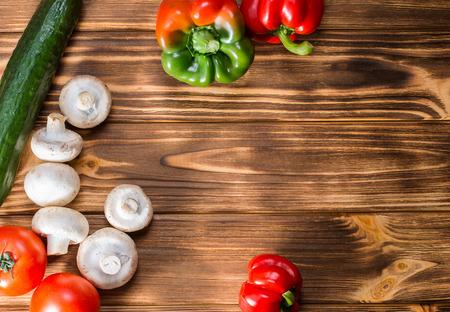 green vegetables: vegetables on the wooden background.