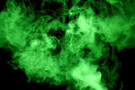 green steam on the black background. Stock Photo