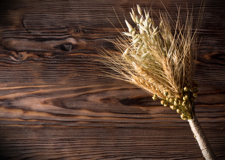sheaf: sheaf of ears on the wooden background. Stock Photo