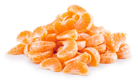 sweet segments: handful of tangerine slices isolated on the white background. Stock Photo