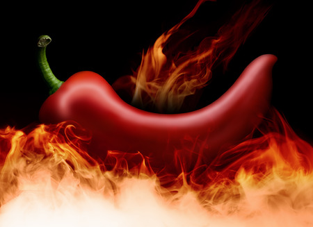 red hot chilli pepper in flames on black background. Stock Photo