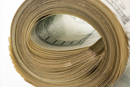 money roll: money roll dollars isolated on the white background. Stock Photo