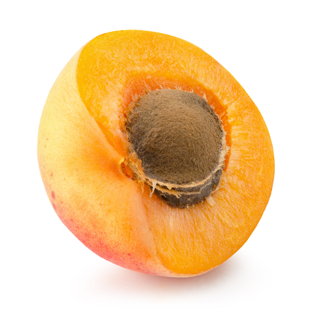 apricot kernel: half of apricot isolated on the white background.