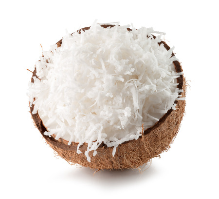 half of coconut with coconut flakes isolated on the white background.